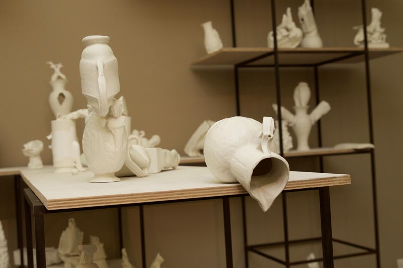 A collection of white porcelain objects on industrial shelving